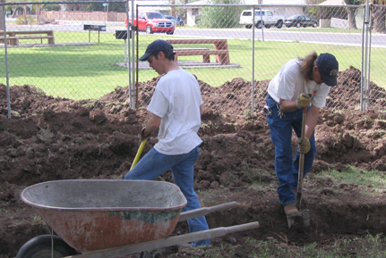 Neighbors Kyle Woodson and Mike Wiese are in the trenches helping out.